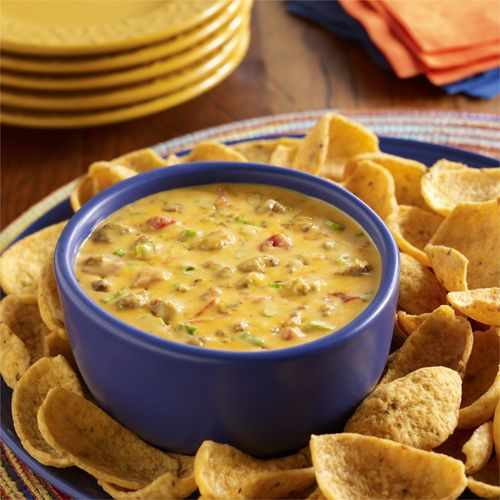Queso recipe made special by adding flavorful chorizo to Ro*Tel zesty tomatoes and Velveeta dip.  Velveeta is a brand of Kraft Foods Inc.