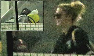 http://www.dailymail.co.uk/news/article-3282728/Khloe-Kardashian-walks-Lamar-Odom-transferred-LA-hospital-basketball-star-told-estranged-wife-love-you.html