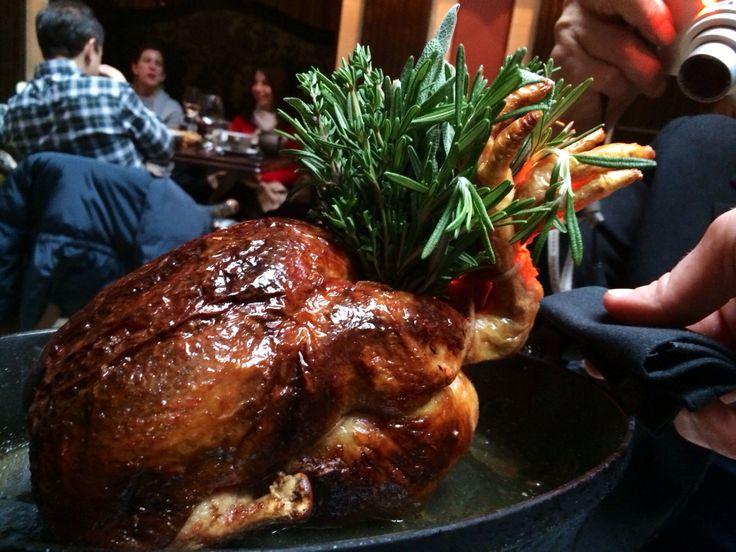 Roast chicken stuffed with foie gras and truffles at The Nomad restaurant inside The Nomad Hotel in NYC