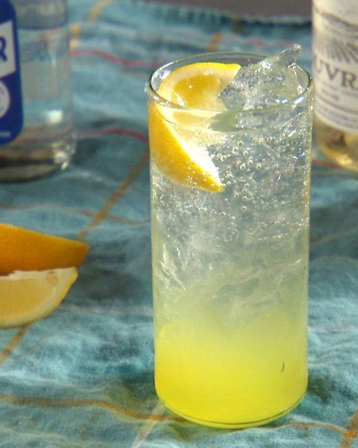 Limoncello Spritzer Recipe - Fill a glass with ice.  Fill glass halfway with wine. Pour in a few tablespoons of limoncello. Top off with club soda. Squeeze lemon wedge in and stir to combine.