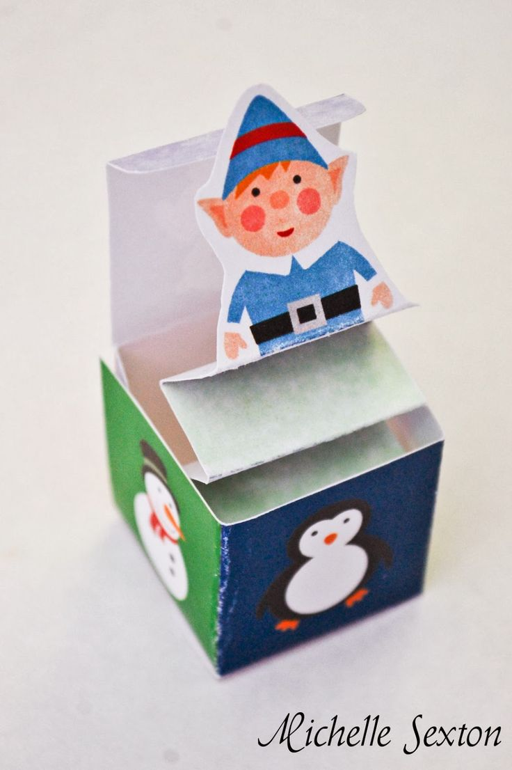 I have a fun little project for you guys today - a miniature Jack-in-the-box paper Christmas craft. So fun and cute! This little Jack-in-the...