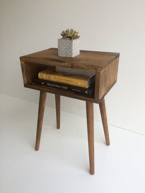 This Mid-Century inspired open shelf end table is sure to stand out.   These tables are handcrafted with poplar and oak wood that is finished with