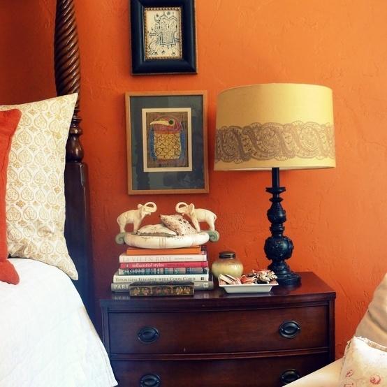 A spicy Indian orange bedroom.