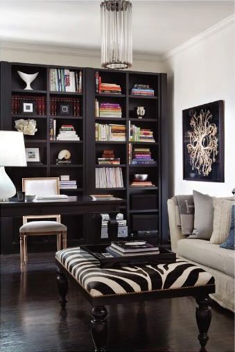Nice dark bookshelves.  Love how the dark desk vanishes into the bookshelves.
