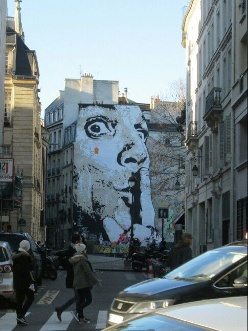 paris near pompedou centre street art whispering