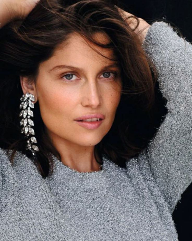 Model Laetitia Casta gets her closeup in chandelier earrings