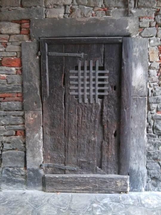An old door in Città Alta, Bergamo, Italy - photo by archiLAURA