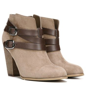 Add allure with the Helene booties from Carlos by Carlos Santana.Faux suede upper in a bootie style with a round toeSide zip closureDecorative contrasting strap and buckle detailsSmooth lining, cushioning insole for all-day comfortTraction outsole for stability, 3+ inch chunky heel