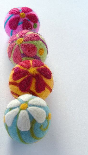 Needle felting - use out felt balls or eggs as the base and then belling with our wool !