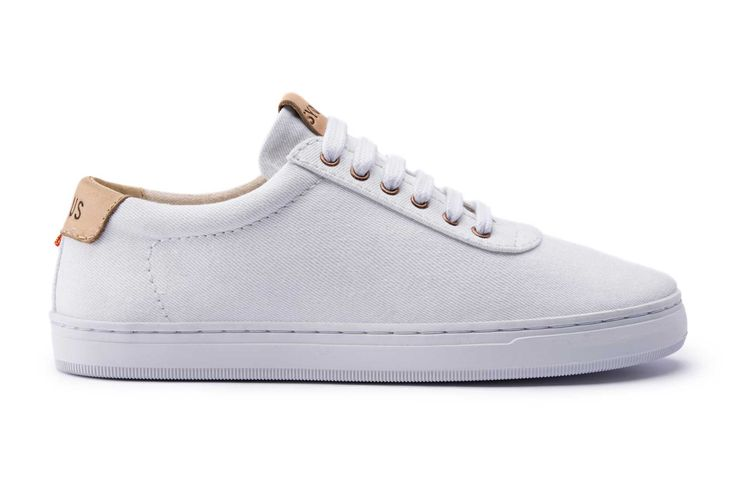 The SYOU CO.1 ALL WHITE BASIC Sneaker in white features a full paneled canvas upper. 100% made and sourced in Colombia, South America with minimal branding. Get yours at SYOU.com