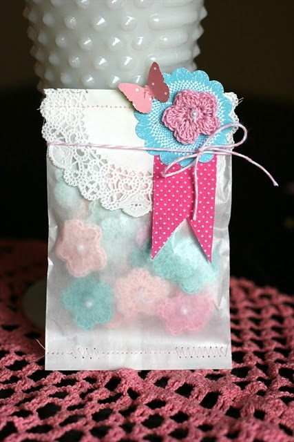 Crochet flowers in pretty packaging.