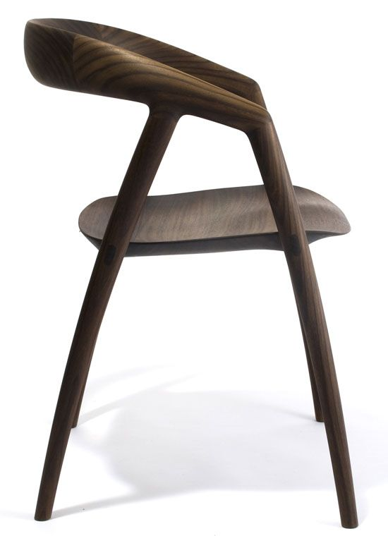 DC09 Dining Chair by Inoda & Sveje: Sculpted out of solid wood, the seat has been shaved as thin as possible. Available in Indonesian rose wood, teak and ash.