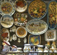 How to Decorate a Kitchen Tuscan Style: Accessorize with Italian ceramics.   Tuscany is world famous for its rustic, sun-drenched villas and its fabulous, earthy food. You can bring these elements into your own home and create a Tuscan style kitchen that is beautiful to look at and a pleasure to cook in. Be sure to make room for a large farmhouse table and plenty of dining chairs, as your family and friends will gravitate towards this inviting room. Things You'll Need:   Latex-based paint…
