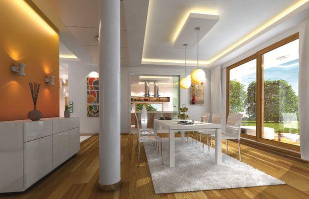Widok na jadalnię oraz fragment kuchni. Naturalne światło zapewni cała ściana z okien. Zobacz rzuty projektu.