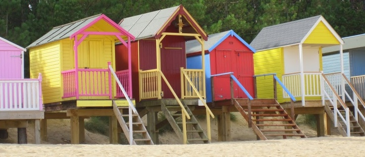 colourful beach huts on the North Norfolk coast
