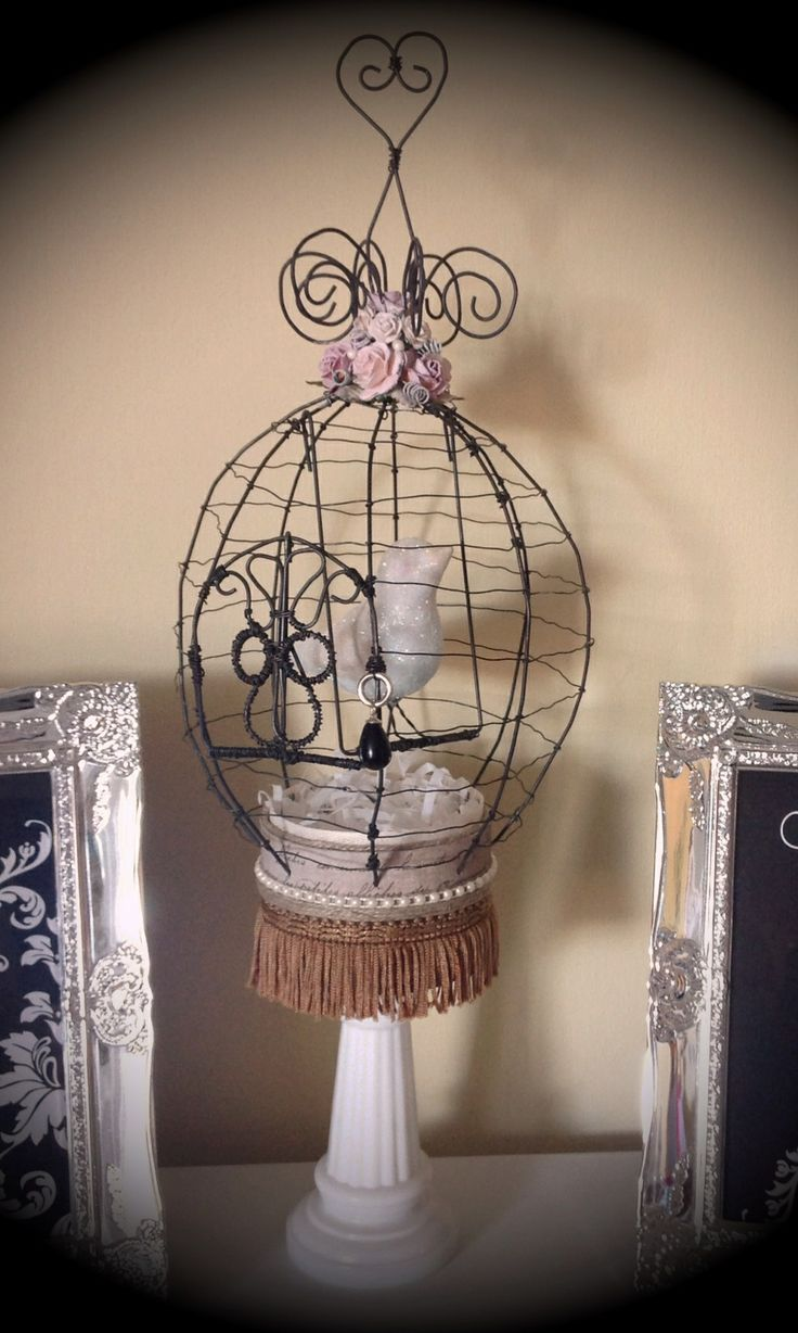 A birdcage made out of wire and #vintage #findings.