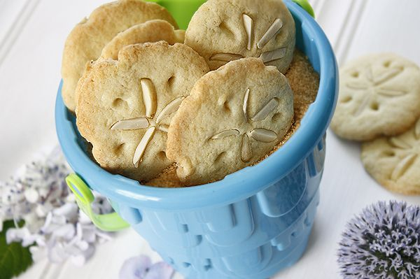"Sand dollar cookies in a ""beach pail"". Sweet!  Recipes here: http://www.completely-coastal.com/2010/11/pillsbury-cookie-recipe-for-sand.html Easiest cookies to make!"