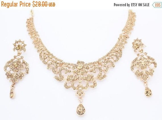 Three row gold pearl/diamante gold plated necklace set ACaLO