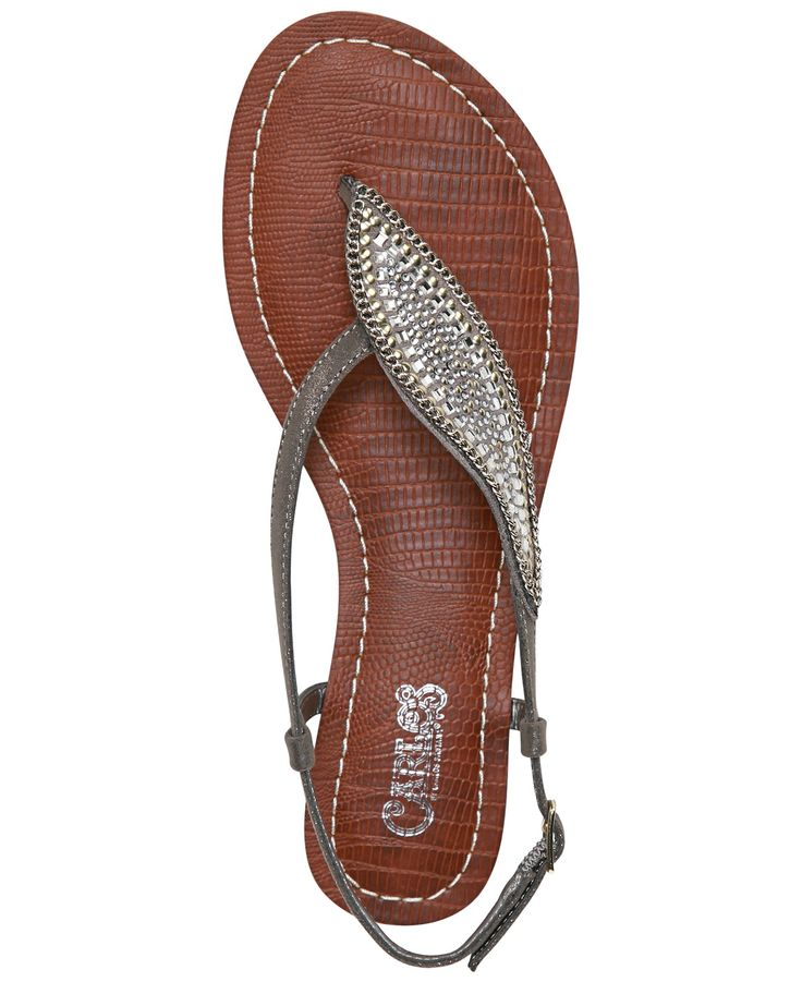 Carlos by Carlos Santana adds a unique touch to these Laverne sandals with an asymmetrical sparkling embellishment across the instep. | Manmade upper; manmade sole | Imported | Open split-toe asymmetr