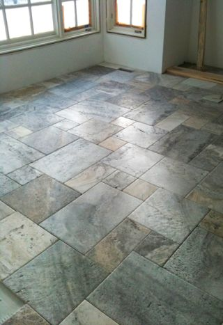 Picasso travertine floor arranged in a Versailles pattern.