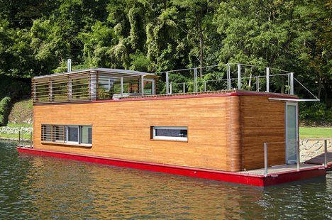 modern houseboat won't go fast, but no property taxes in the slip!