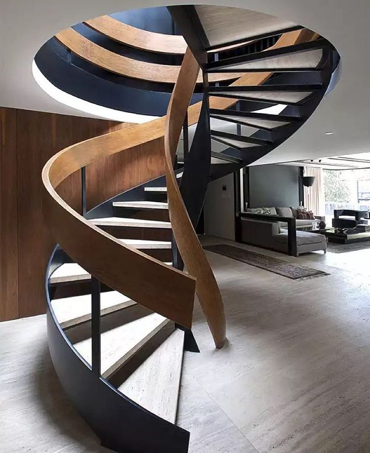 """""""The strips of #wood and #metal on this #staircase seem to intertwine as if in dance, wouldn't you agree? Designed by @calzadapaola \\\ Photo by…"""""""