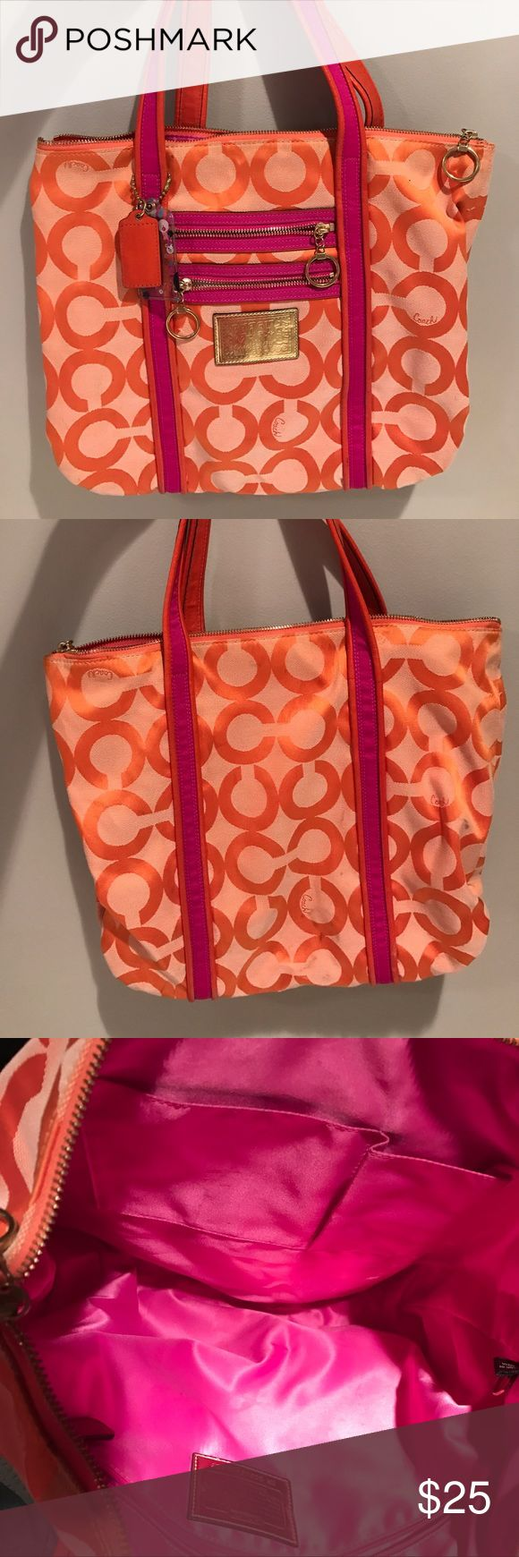 Coach tote bag, pink and orange, great condition Coach tote in pink and orange signature logo, three inside pockets. Outside is great condition save for slight smudges on the back, inside shows slight wear such as pen stains. Coach Bags Totes
