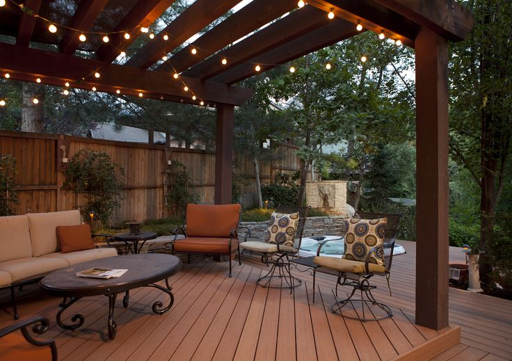 Platform decks and pergola define this fun and functional outdoor entertaining space.