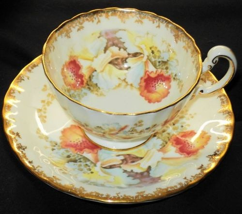 AYNSLEY ORANGE ORCHID GOLD TEA CUP AND SAUCER  125.00
