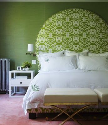 I love this! Can't tell if it's a headboard with fabric or just a circle of wallpaper awesomeness... but I love it!