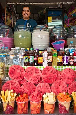 """Guadalajara, Jalisco, México. In the market, jars with """"Aguas Frescas"""" (beverages with fresh fruits)."""