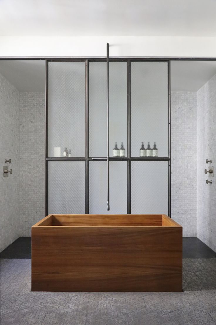 Japanese style soaking tub, safety glass, amazing floor tiles from ? ann Sacks. A Rugged, Rustic NYC Loft by Matt Bear of Union Studio: Remodelista