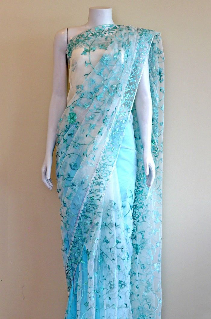 White net sari with sea blue accents- same darker blue on light blue color palette