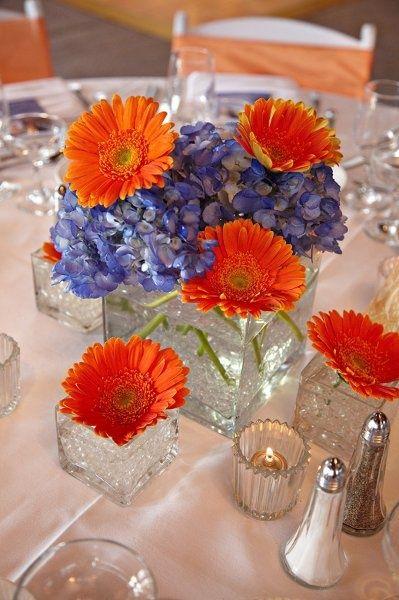 56 best images about blue orange wedding on pinterest for Orange centerpieces for tables