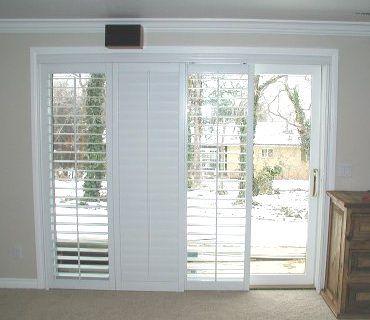 Plantation shutters on sliding glass door for family for Three pane sliding glass door