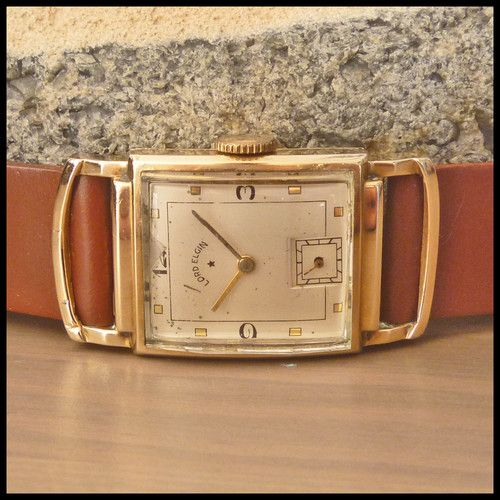 1940's LORD ELGIN [USA] Vintage Driver Watch; YG 21j HW Elgin Cal. 559 Movement http://www.thesterlingsilver.com/product/marc-jacobs-mbm3330-36mm-gold-steel-bracelet-case-mineral-womens-watch/