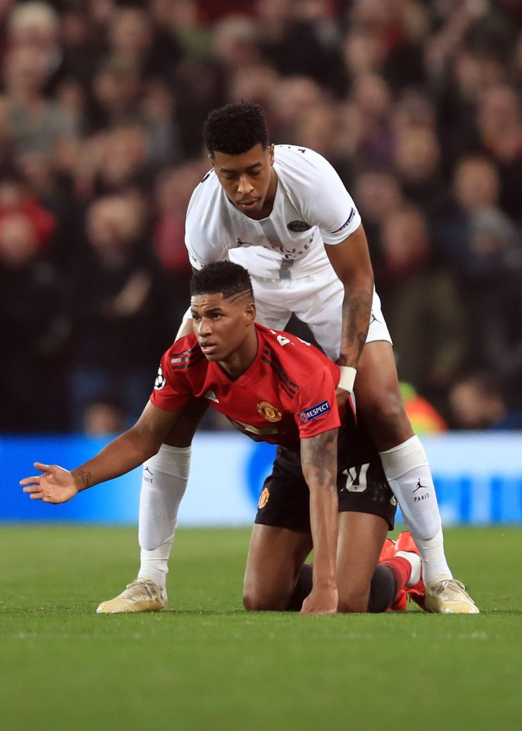 Marcus Rashford Of Manchester United Is Helped To His Feet By Presnel Marcus Rashford Manchester United The Unit