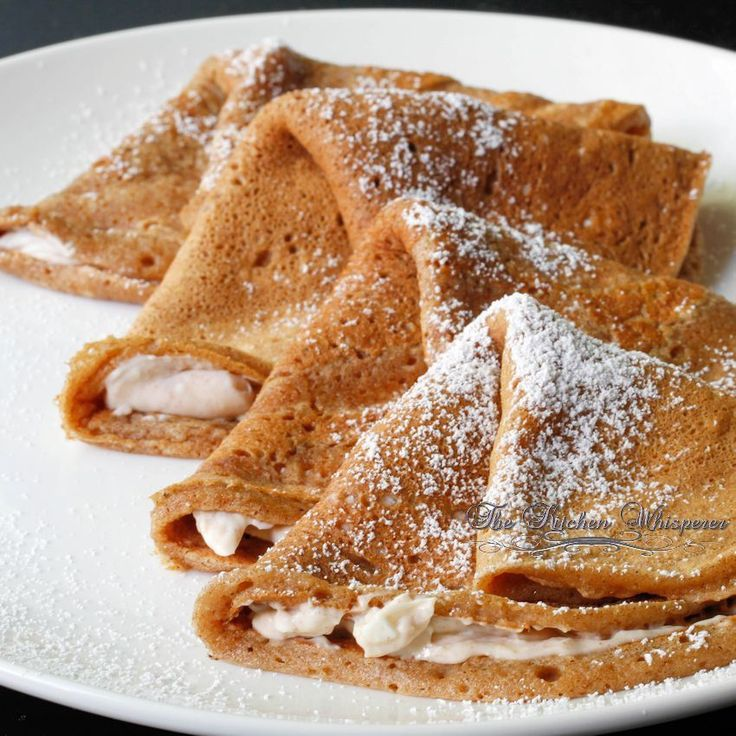 Celebrate Pumpkin season with these Harvest Spice Pumpkin Crepes with Cinnamon Cream Filling from The Kitchen Whisperer: