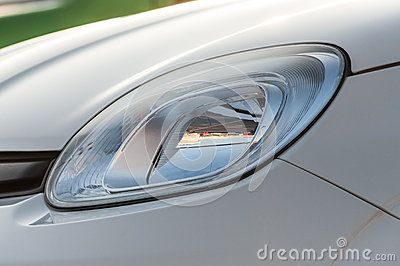Closeup of a new car headlight.