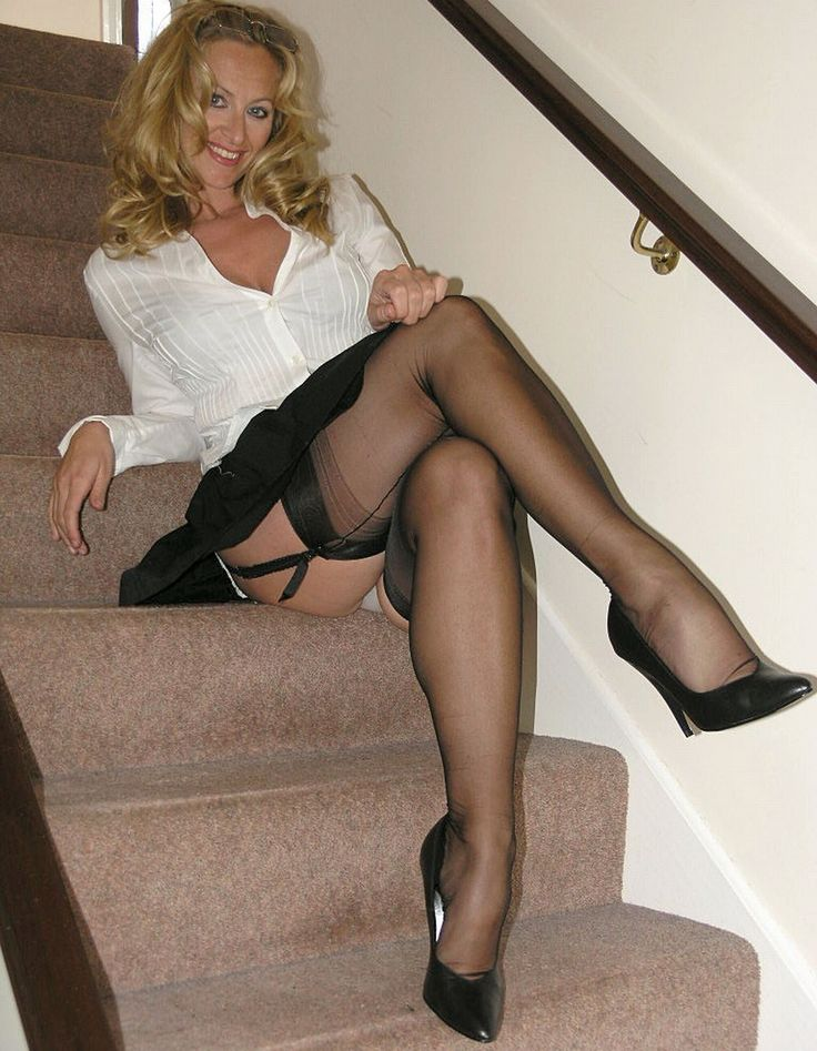 Lusty mature woman in stockings