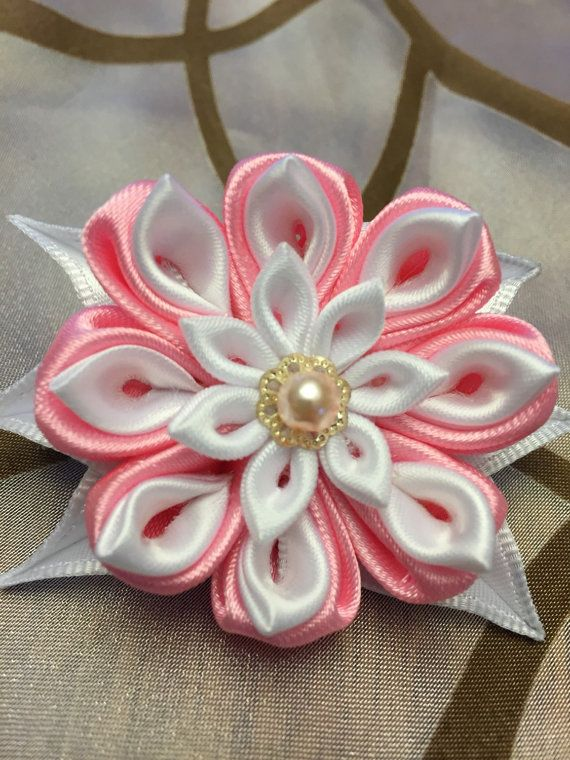 Pink and sweet flower hair barrette made in a Japanese style of kanzashi, every petal is individually cut and folded to create this cute hair piece.