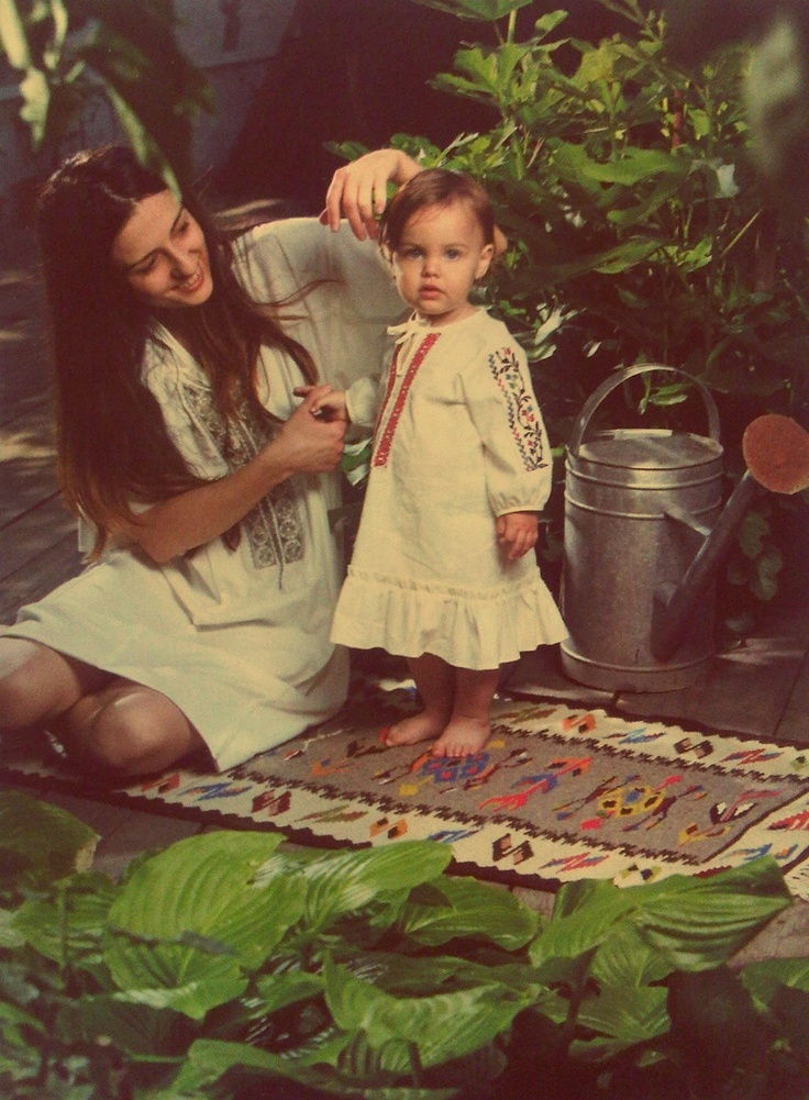 sweet romanian girls..reminds me of me and my mother .. We have similar photo