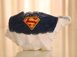 "Navy blue lace ""Superman"" themed garter set."