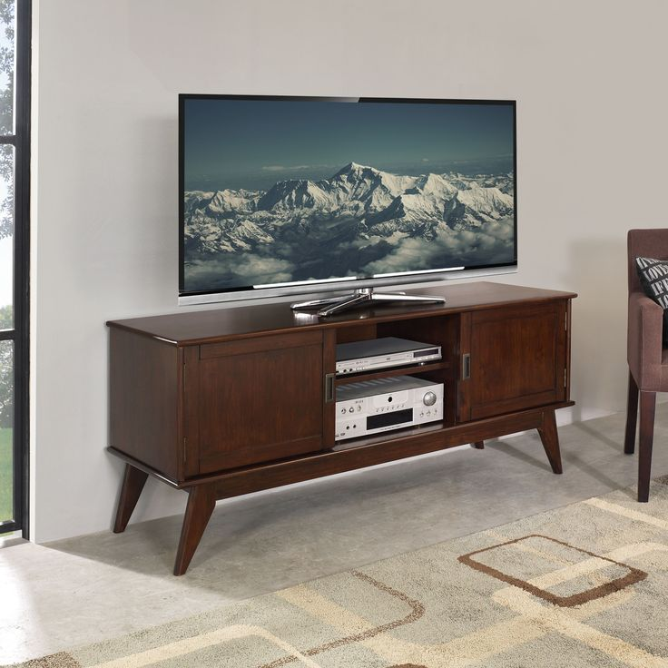 The Tierney Mid-century modern Low TV Media Stand is a well-designed piece of furniture. The center features two (2) shelves with cable management cutouts for your electronics.