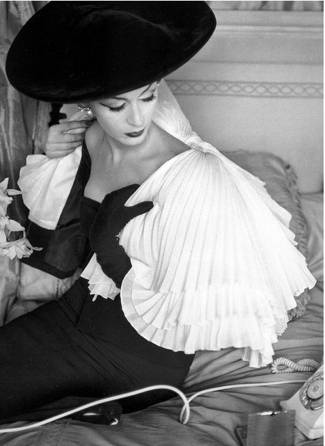 Dovima. Vogue, April 1956. Pleated capelet and black dress by Jacques Fath. Photo: Henry Clarke.