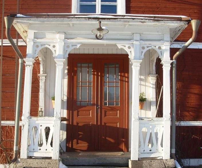 Beautiful entrance to an old red house