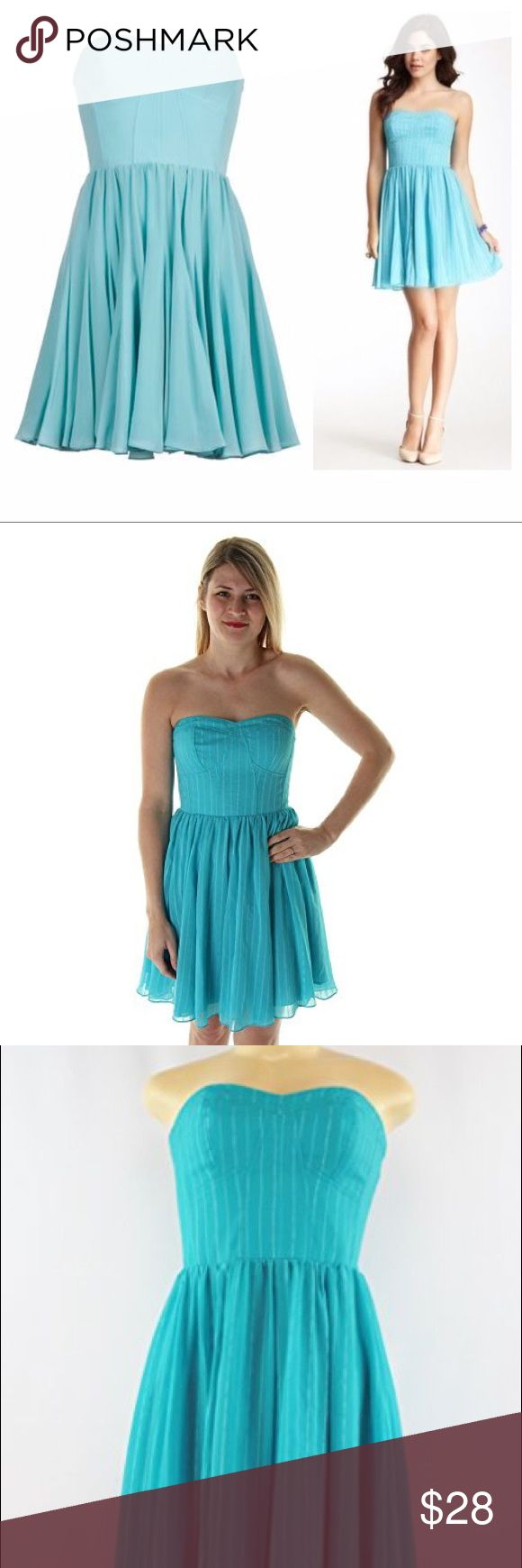 """Guess strapless bustier dress Like new, worn only once. Lined Guess chiffon turquoise blue strapless bustier dress with metallic silver stripes. Elastic back. Back zip. So cute. Flowy chiffon. Polyester. Length 28"""" pit to pit 14.5"""" waist flat across 12.5-13"""". Color most accurate in second and third photos. Guess Dresses Strapless"""