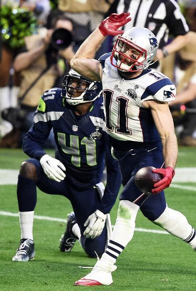 New England Patriots vs. Seattle Seahawks - Julian Edelman #11 of the New England Patriots reacts after making a catch over Byron Maxwell #41 of the Seattle Seahawks in the second quarter during Super Bowl XLIX at University of Phoenix Stadium on February 1, 2015 in Glendale, Arizona. (Photo by Harry How/Getty Images)