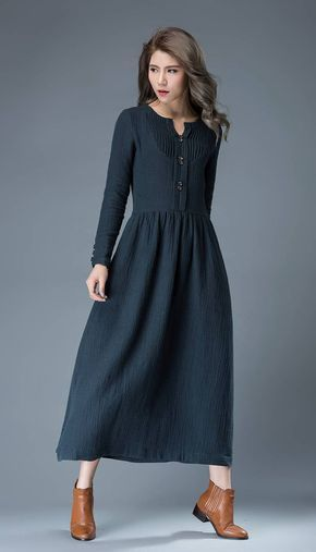 This navy blue summer dress has timeless appeal. Wear your hair in loose waves, add chunky jewelry and gladiator sandals for a more boho style. Equally, this dress would look great with court shoes, a clutch handbag and a chunky belt for wearing to the office. This is a very versatile dress than can be dressed up or down and worn everyday or to the office. The navy blue linen dress has some gorgeous pintuck details on the bodice, buttons on the front and also on the cuffs of the sleeves…