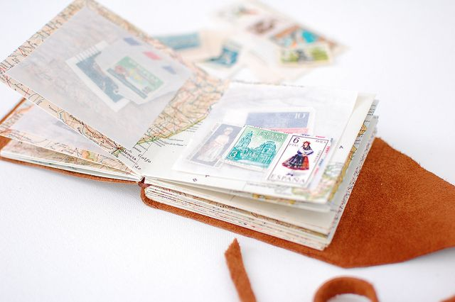 Stamp collection book using glassine envelopes & repurposed maps!  http://blog.giddygiddy.com/giddygiddy/2011/04/diy-mini-stamp-collecting-book-.html